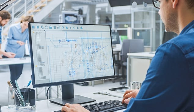 Man working on CAD drawing for company that has managed it