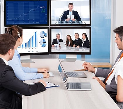 employees video conferencing with others to discuss data security