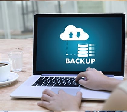 it consultant running a computer backup on a laptop