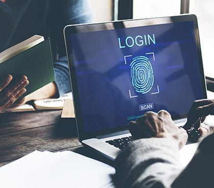 laptop screen with login page for computer security