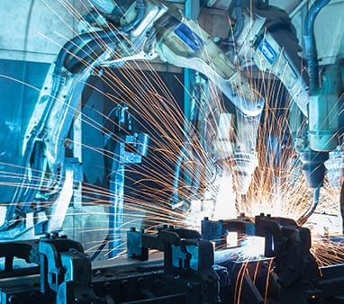 robotic manufacturing arm welding metal for company that has network security