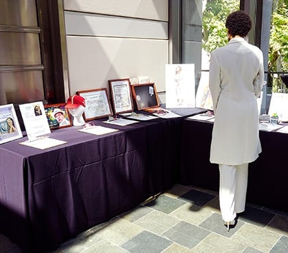 woman at silent auction event for company that uses information security